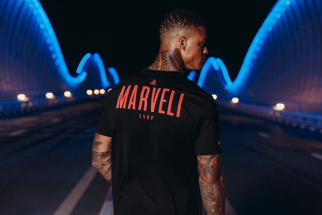 Marveli Men's Fashion in Dubai - Model Wearing LKDP Black Printed T-Shirt on Bridge