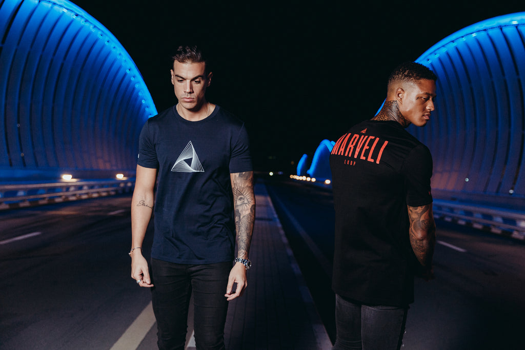 Marveli Men's Fashion in Dubai - Models Wearing LKDP Black and Marveli Logo Navy Blue Printed T-Shirts 2 on Bridge