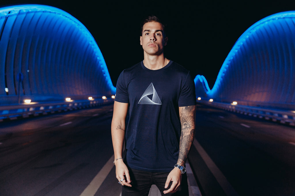 Marveli Men's Fashion in Dubai - Model Wearing Marveli Logo Navy Blue Printed T-Shirt on Bridge