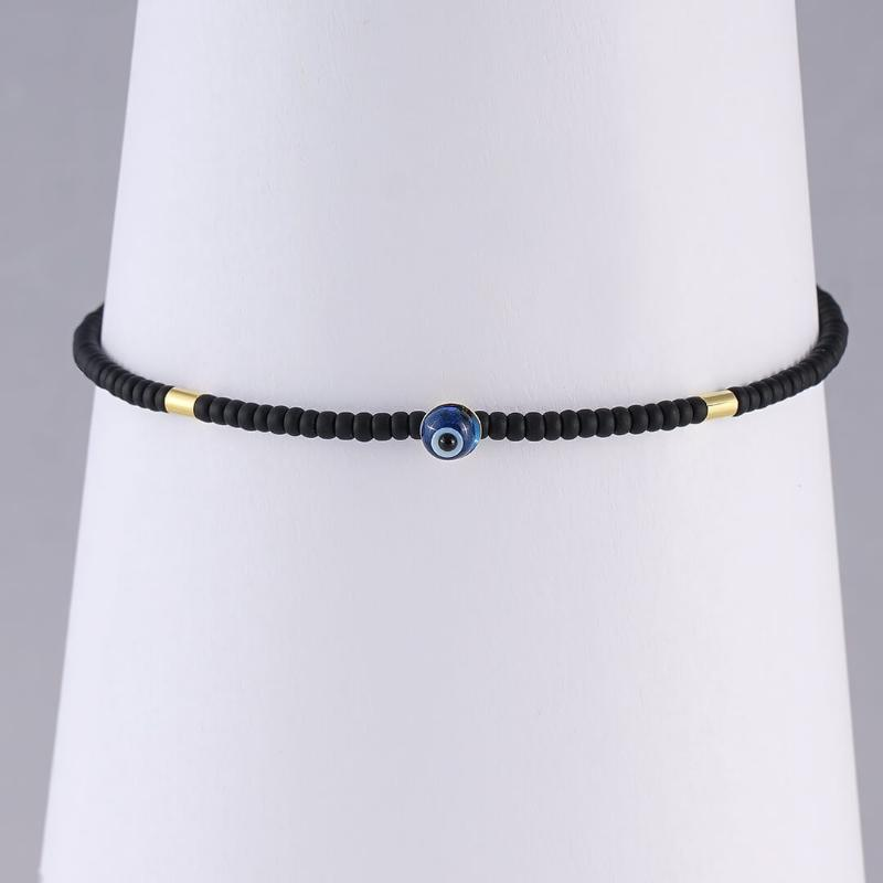 Subtle Evil Eye Bracelet with black beads, for men and women
