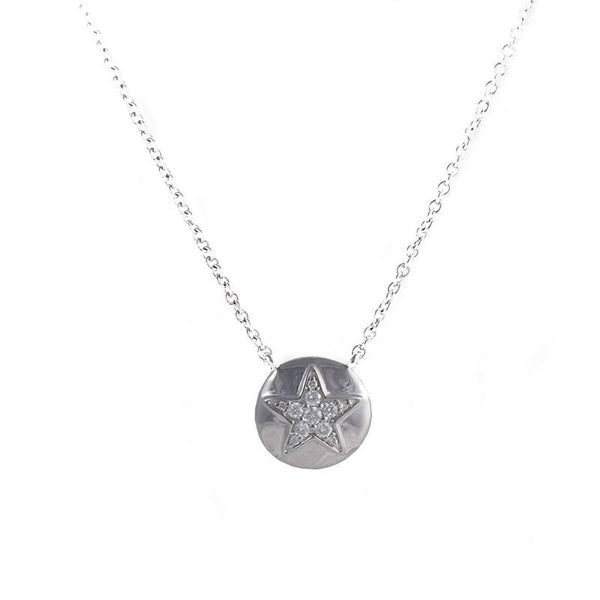18kt White Gold, subtle star pendant with diamonds in the center.