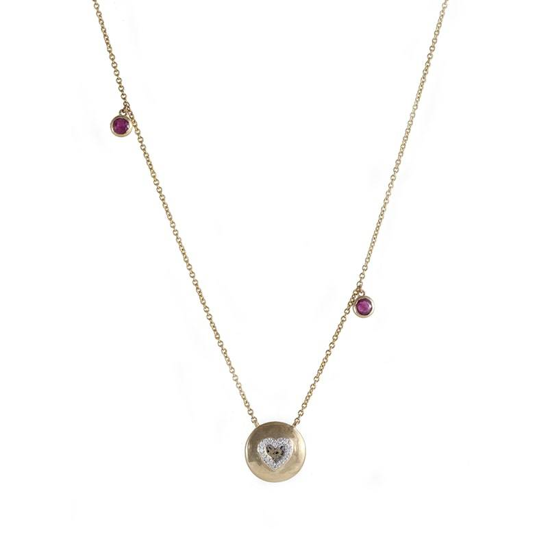 18kt Yellow Gold, subtle pendant with a heart shaped charm with diamonds in the center and two round shaped Rubis on the chain