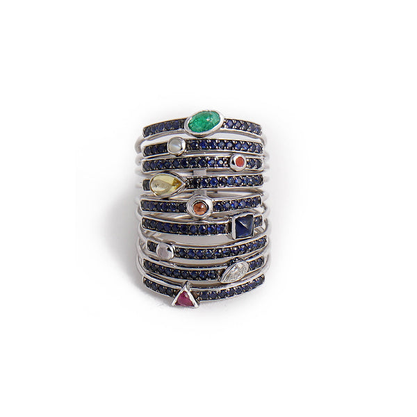 18kt white gold and sapphire harem ring, set with 9 Navaratna gems.
