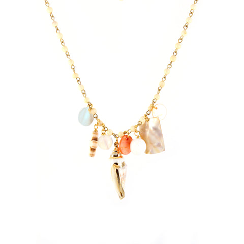Oana Necklace Mermaid Collection with light wood rosary, assorted charms and large gold tone seashell pendant