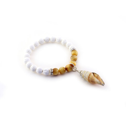 Calina Bracelet of cream lava, Tiger eye and sparkling channel set rondells suspend a beautiful silver tone seashell pendant . Part of our Mermaid Collection