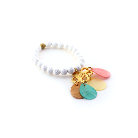 Cream lava rock aromatherapy bracelet diffuses your favorite essential oil. Beautiful, multi-colored Capiz shells suspend by an abstract focal charm. Part of our mermaid collection