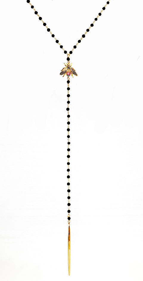 Lava rock rosary necklace with rhinestone moth and gold tassel