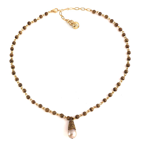 Elsa Necklace - Hand tooled Tibetan brass capped pearl dropped from taupe wood chain