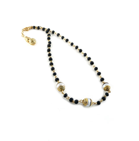 Hallie Necklace - Noir wood rosary with hand tooled Tibetan brass capped pearls