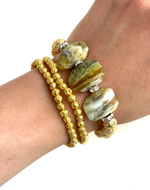Canary Opal faceted tablets with gold luxe lava stacked bracelets. Anoint will our signature Hot Scents oil to use as a personal diffuser. Playa Collection.