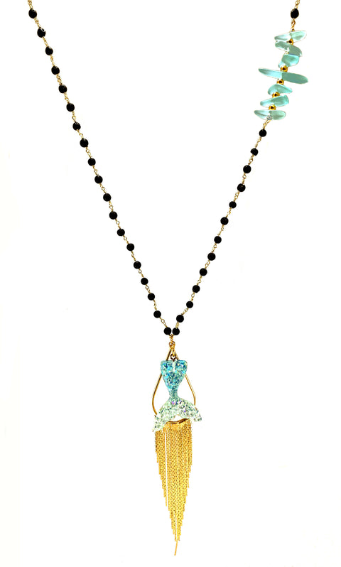 Mermaid Collection Tail Necklace - black Lava rosary chain adorned with colorful fishbone style accent suspends glittery mermaid tail pendant and gold tone tassel