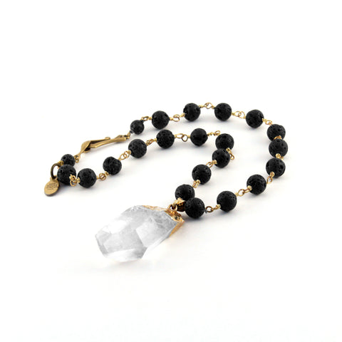 Quartz crystal pendant suspends from natural lava rock aromatherapy rosary chain. Blogger favorite - perfect necklace for layering