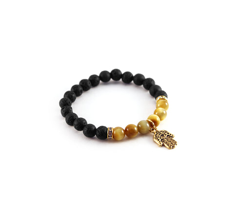 "Mantra ""I am protected"" bracelet with natural black lava rocks to diffuse amber oil with notes of cozy balsam and oriental spice with tiger eye stones for security and confidence - Hot Rocks Jewels"