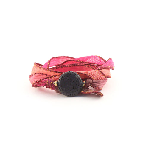 Gorgeous silk ombre ribbon wrap with Lava stone center. A versatile staple piece to heat up your jewelry collection. Can be worn a variety of ways including bracelet, choker and necklace. Part of our Mermaid Collection