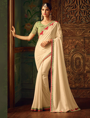 Deigner Partywear Wedding Beige Georgette Embroidered Border Work Saree By Takshaya