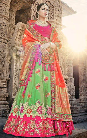 Designer Wedding Wear Semi- Stitched Green Orange and Magenta Silk Lehenga