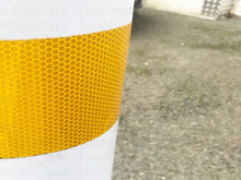 High Intensity Yellow Reflective Tape Stuck to a Post