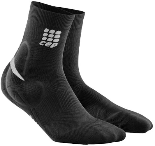 Pair of CEP black ankle support socks with a silicone pad over the malleolus for added protection