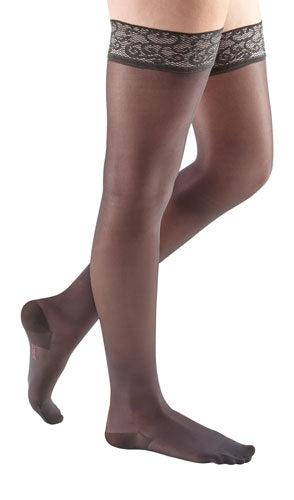women's legs wearing a pair of Mediven Sheer & Soft thigh highs in the color toffeeblack