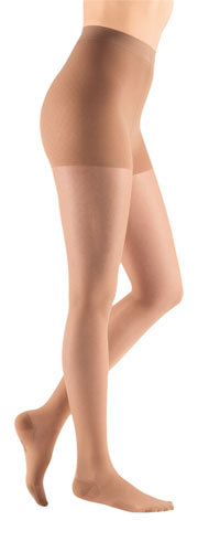 lady wearing her Mediven Sheer & Soft compression pantyhose in the color natural