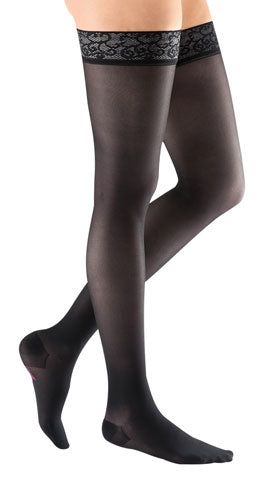 womens legs wearing Mediven thigh-high sheer and soft compression stockings in the color black and compression level 8-15 mmHg