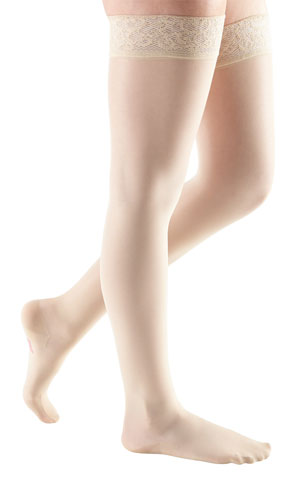 women's legs wearing a pair of Mediven Sheer & Soft thigh highs in the color natural