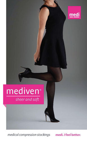 lady wearing a black dress playfully showing off her black mediven sheer and soft compression stockings