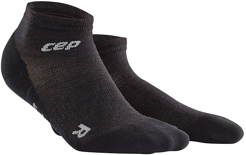 A pair of CEP Merino low-cut ankle socks in the color lava stone