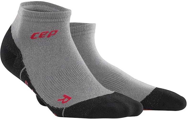 A pair of CEP Merino low-cut ankle socks in the color volcanic dust