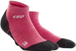 A pair of CEP Merino low-cut ankle socks in the color wild berry