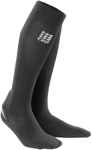 Pair of knee high CEP black Achilles support socks that show a padded area around the achilles tendon for added protection