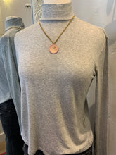 Mock Neck Heather Grey pullover.