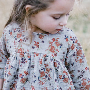 little girl in knee-length floral dress