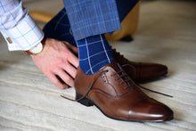 Elegant blue dress socks for a formal occasion with a matching outfit