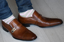 Man wearing pink striped socks with brown monk strap shoes