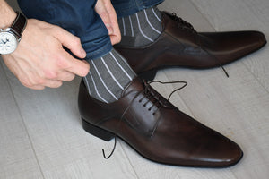 Grey socks for men with vertical stripes matching casual outfit