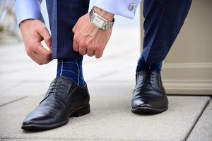 Men's blue checkered dress socks with a matching corporate look