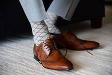 Men's fashion dress socks matching grey suit and brown derby shoes