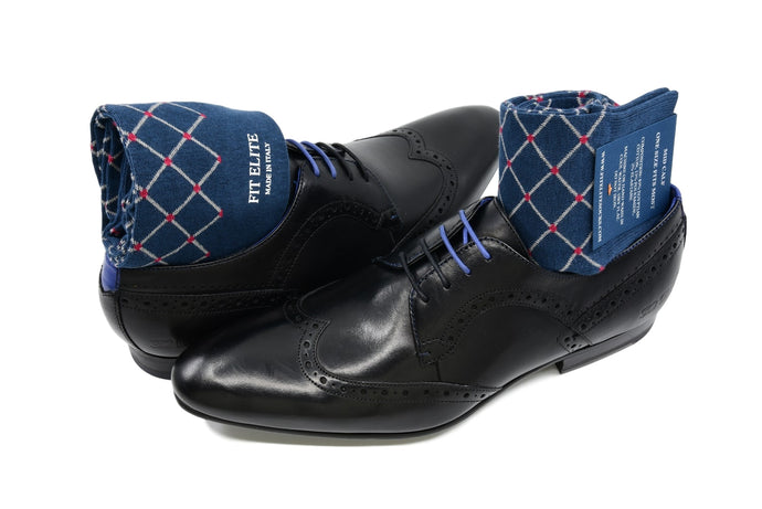 Men's patterned dress socks, navy blue with red polka dots design, inside black dress shoes