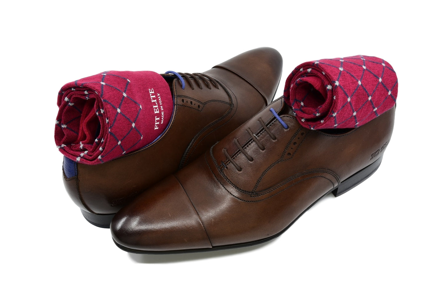 Men's patterned dress socks, red with grey polka dots, inside brown dress shoes