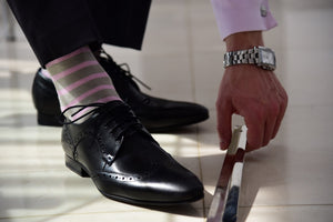 Men's pink striped socks for a formal occasion matching pink dress shirt
