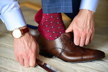 Man wearing luxury red dress socks with brown oxford shoes