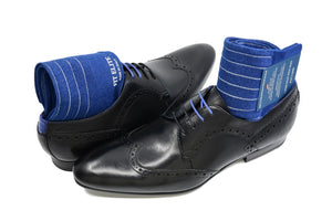 Men's ribbed dress socks, blue with grey vertical stripes, displayed inside black shoes