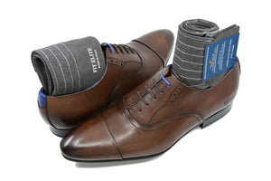 Men's ribbed dress socks, grey with purple stripes, displayed inside brown dress shoes