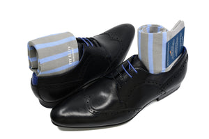 Men's striped dress socks, blue and grey, displayed inside black shoes