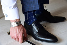 Trendy dress socks for men with a checkered design, matching cufflinks and a square watch