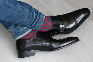 Men's navy blue and red striped dress socks, displayed inside brown dress shoes