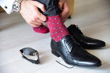 Business socks for men with grey polka dots matching accessories and black suit