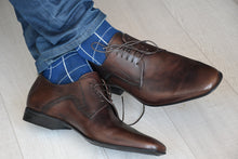 Stylish check patterned blue socks for men with matching blue jeans and brown shoes