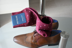 Express yourself with our stylish burgundy polka dot dress socks for men